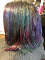 Multi-colored head of hair.